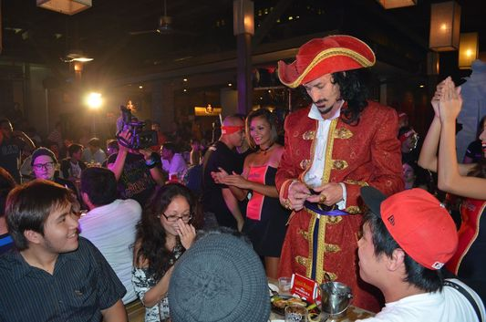 Captain Morgan giving a key to treasure box at Captain Morgan party in Manila