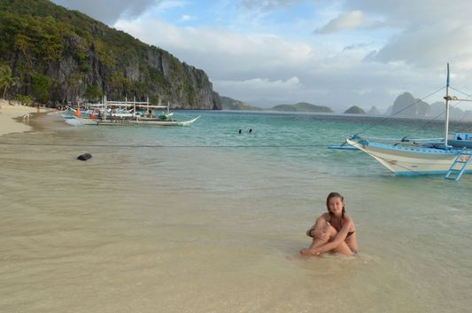 crazy sexy fun traveler on 7 Commandos island beach in Palawan