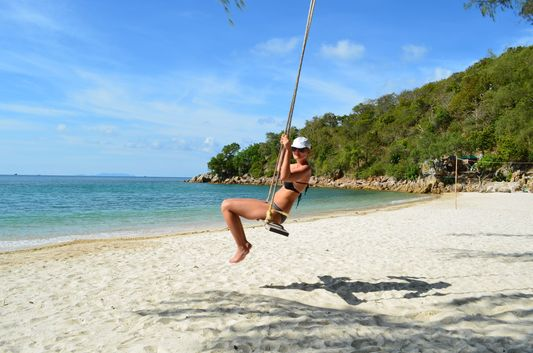 crazy sexy fun traveler on Coconut beach on Koh Phangan island in Thailand