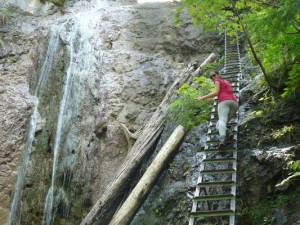 climbing up the waterfall in Slovensky raj in Slovakia
