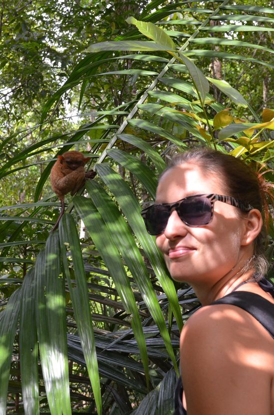 crazy sexy fun traveler with a tarsier in Bohol