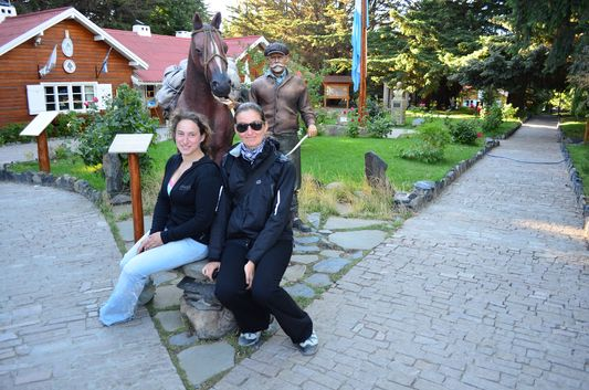 inside Intendencia Parque Nacional de los Glaciares with Francisco Moreno statue - me and Lyra