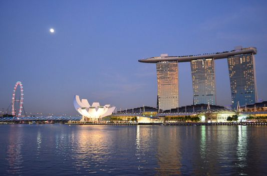 full moon above Marina Bay Sands Hotel, Science Museum and Singapore Flyer