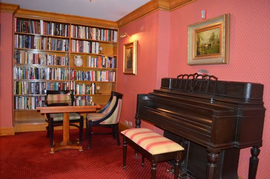 piano and books in Club room in Elysee hotel