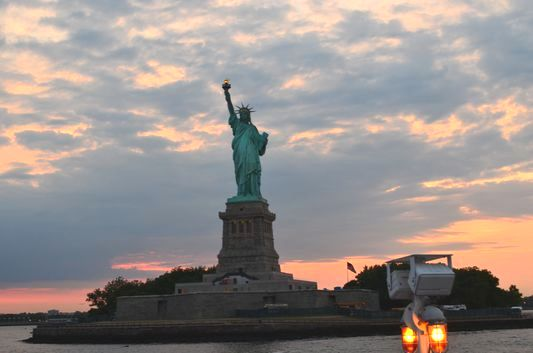 the Statue of Liberty at sunset seen from Circle Line Cruise with CityPASS