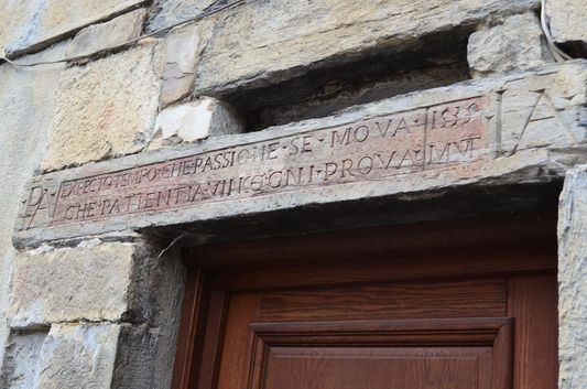 Latin monograms on the houses in Pigna