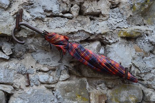 an umbrella on the wall in Pigna
