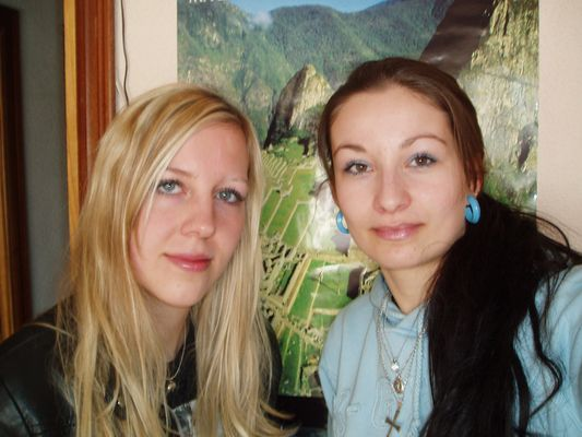 with my friend Kami in Madrird with Machu Picchu photo behind