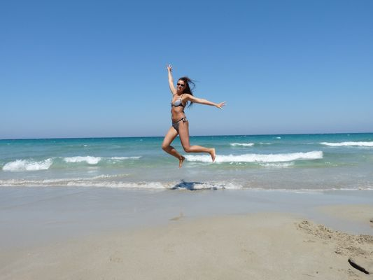 jumping at Torre Guaceto beach