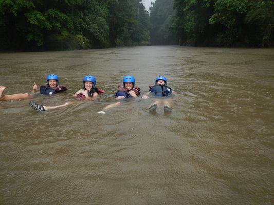 swimming in the rain after rafting Pacuare river in Costa Rica