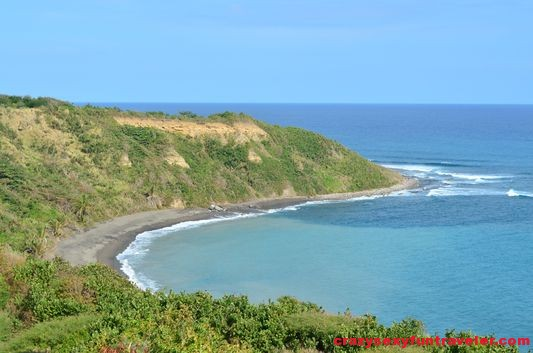 a dark sand beach on St. Kitts