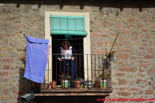 a local woman on the balcony
