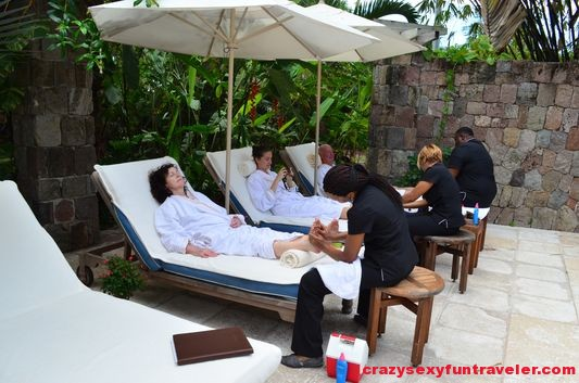 enjoying foot massage in Four Seasons Nevis spa