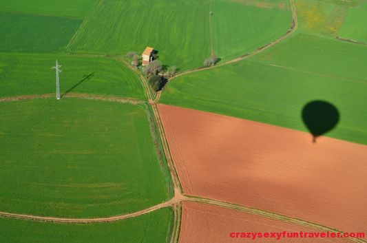 hot air balloon shadow on the fields