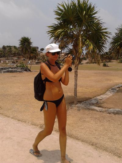 taking photos of the ruins in Tulum