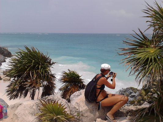taking photos of iguanas in Tulum