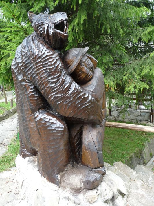 a Goral with a bear - wooden statue of Czyril Kocurek