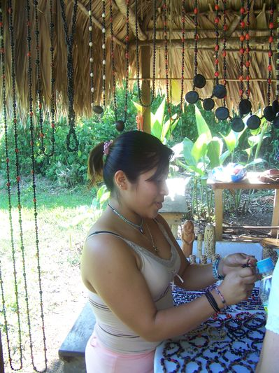 a Lacandon Maya woman selling natural jewelry
