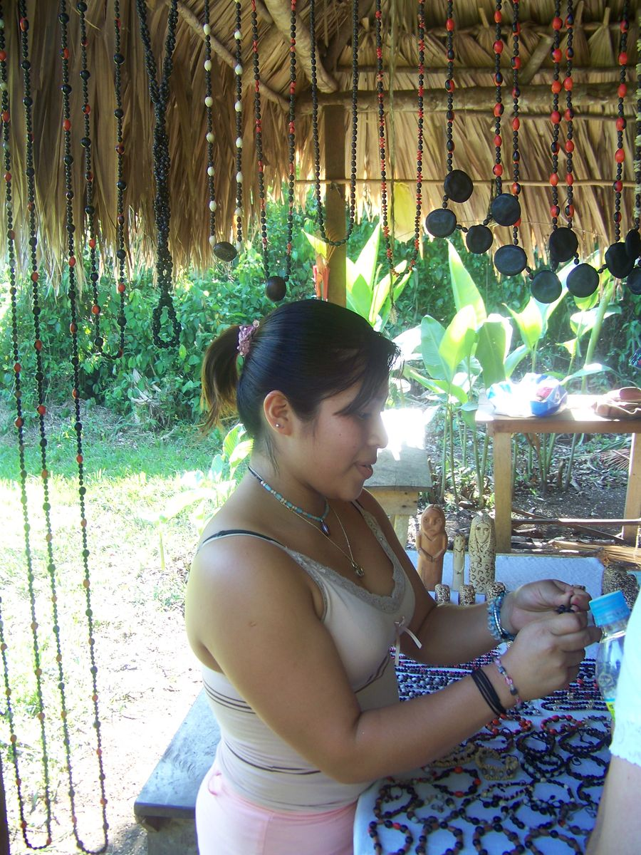 a Lacandon woman selling jewelry