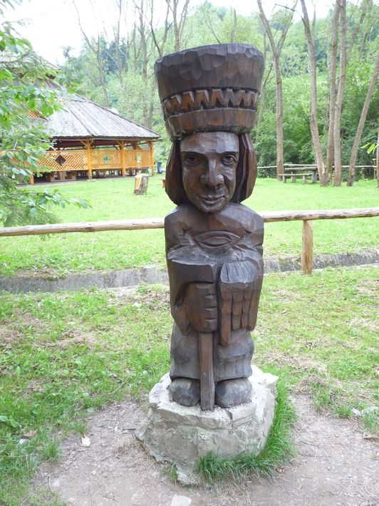 wooden Goral sculpture with a traditional Goral hat