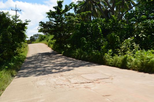 a damaged road on Koh Lanta island in Thailand