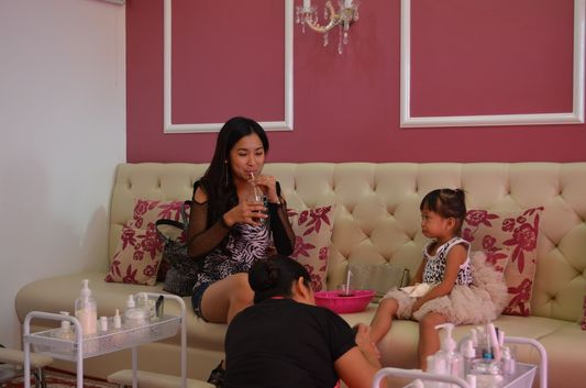 a lady with her little daughter having their pedicure done in Pretty Tipsy Nail and Waxing Salon in Dagupan, Pangasinan, Philippines