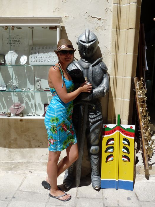 crazy sexy fun traveler with a knight statue in Mdina