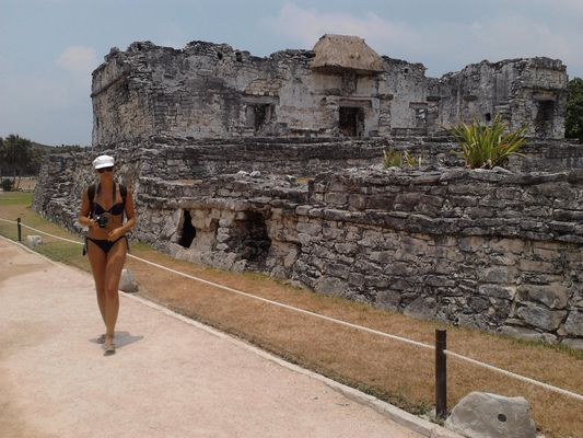 crazy sexy fun traveler in Tulum ruins in Mexico