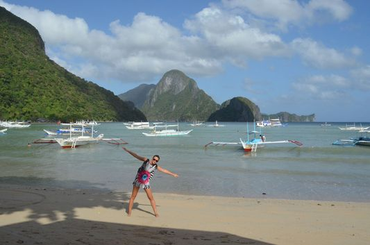 crazy sexy fun traveler on El Nido beach in Palawan