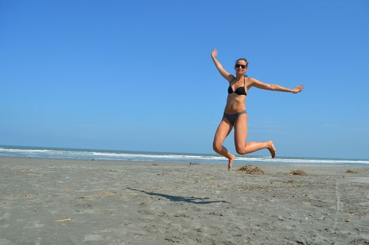 crazy sexy fun traveler on Lingayen beach in Luzon