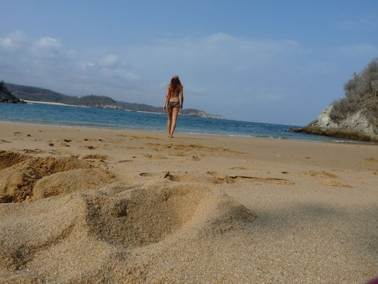 crazy sexy fun traveler on Playa Conejos in Huatulco in Mexico