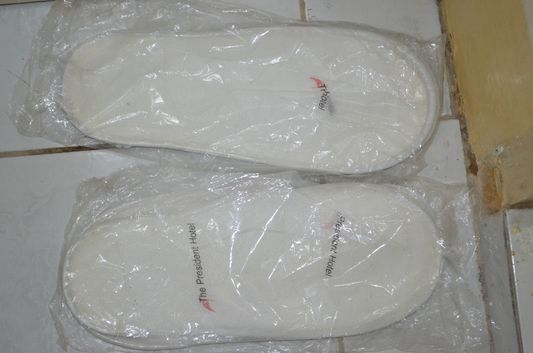 free slippers in Ramos suite, number 125, the President Hotel, Dagupan, Pangasinan, Luzon, Philippines;