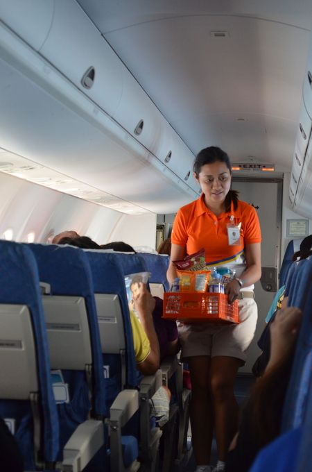 stewardess Angel selling drinks and snacks on Air Phil Express flight 2P 259 from Cebu to Caticlan - Boracay