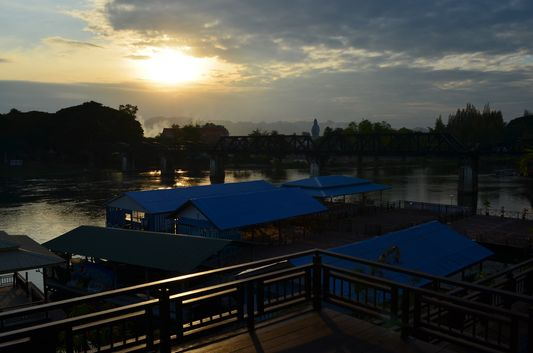 sunset above bridge over Kwai river in Kanchanaburi