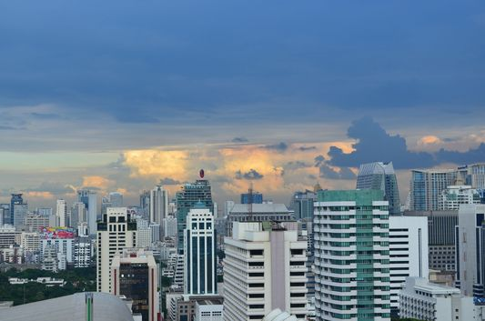 sunset above skyscrapers in Bangkok City Centre in Thailand