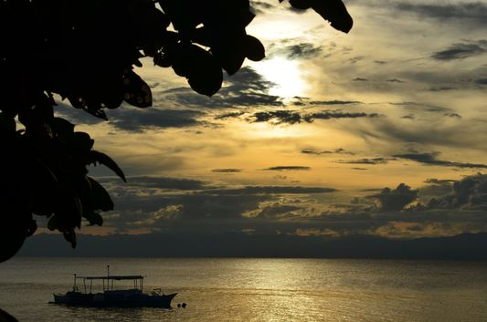 sunset at Basdaku White beach on Cebu island
