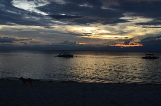 sunset on Basdaku White beach on Cebu island in Philippines