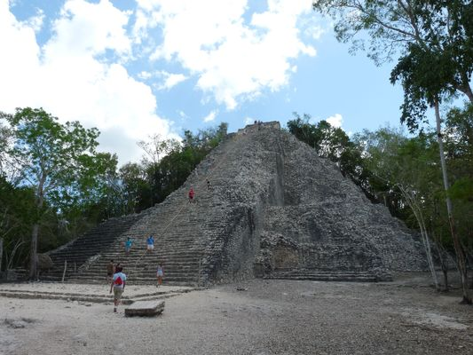 the tallest Nohoch Mul pyramid in Coba ruins in Mexico