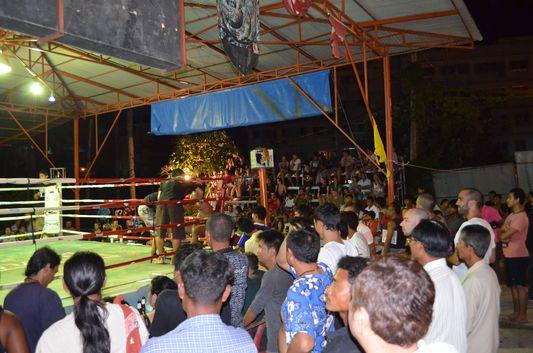 Thai people watching Thai boxing match on Koh Phangan