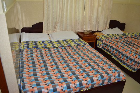 a room with 2 twin beds in Mandalay Inn hotel in Siem Reap