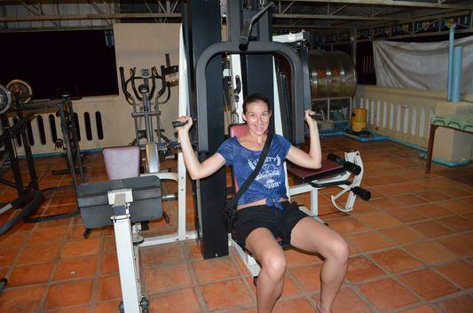 crazy sexy fun traveler exercising in roof top gym in Mandalay Inn in Siem Reap