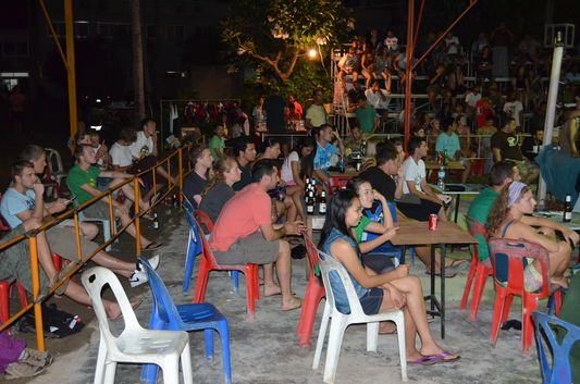 foreigners watching a Thai boxing match on Koh Phangan