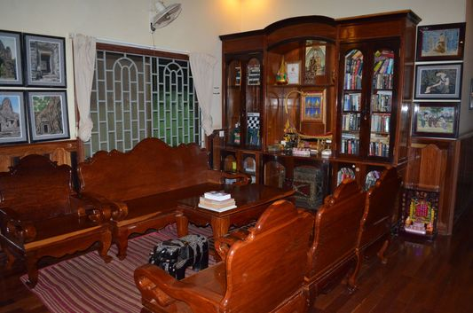 living room of Mandalay Inn with Khmer wooden furniture