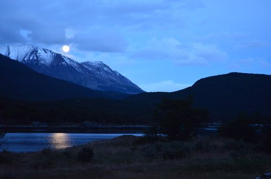 A full moon above Lapataia Bay in Tierra del Fuego