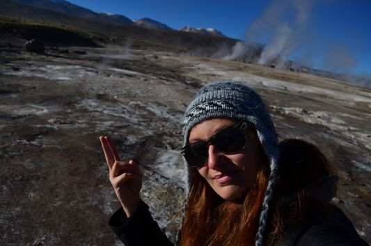 crazy sexy fun traveler happy after swimming in hot springs The Tatio