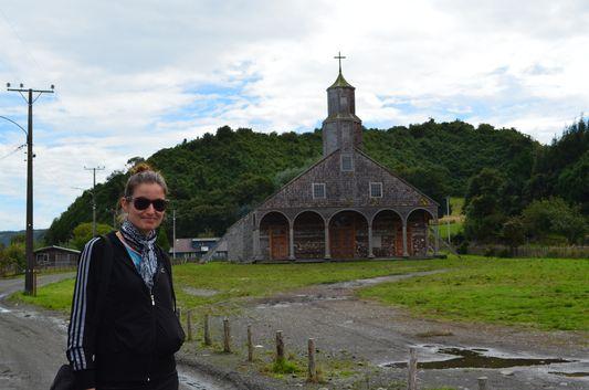 crazy sexy fun traveler outside the church of Villa Quinchao on Quinchao island