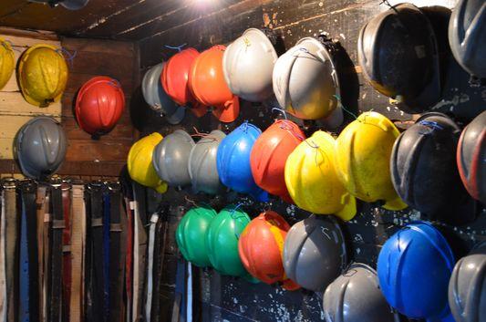 helmets for the visitors to use in Chiflon del Diablo mine in Lota