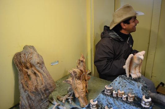 one of the artesanos making wooden handicrafts