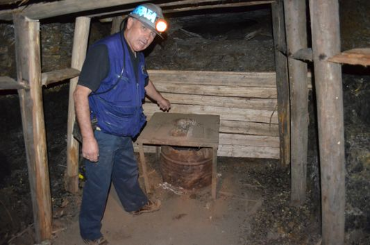 our guide Pedro Arratia showing us the mine toilets in Chiflon del Diablo