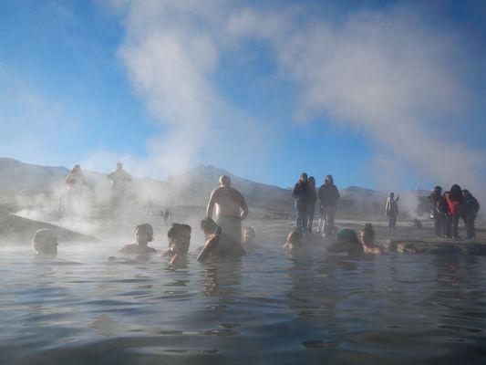 soaking in hot springs of The Tatio